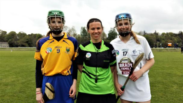 Wicklow under-16 captain Leah Carroll with Kildare's Grace Carragher and referee Suzanne Forde.