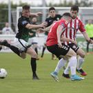 Bray's Anthony Flood back-heels the ball to keep possession during the clash with Derry City
