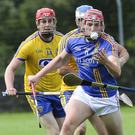 Wicklow's Padraig Doyle comes under pressure from the Roscommon defence