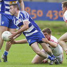 Blessington's Brian Carroll gets his pass away despite the efforts of Tinahely's Rory Stokes during the SFC in Joule park, Aughrim. Picture: Garry O'Neill