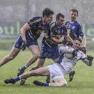 St Pat's Eamonn Wolfe is challenged by Blessington's Bryan Carroll during the SFC quarter final in Joule park, Aughrim. Picture: Garry O'Neill