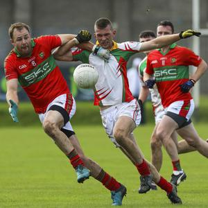 Rathnew's James Stafford and Kiltegan's Rory Finn race for possession during the SFC quarter-final. Picture: Garry O'Neill