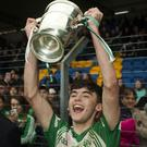 Baltinglass captain Darragh Doyle raises the cup to the cheers of the Baltinglass supporters in Joule Park, Aughrim