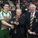 Martin Fitzgerald, Mrs Price and Martin Coleman present the Man of the Match award to Baltinglass's Johnny Keogh