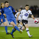 Sean Heaney of Bray Wanderers in action against Ronan Murray of Dundalk