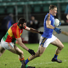 Wicklow's Dean Healy gets away from Carlow's Sean Murphy in Netwatch Cullen Park. Photo: Joe Byrne