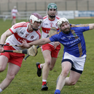 Derry's Darragh McCloskey holds on tight to Wicklow's Andy O'Brien in Bray. Photos: Barbara Flynn
