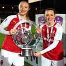 Louise Quinn and Katie McCabe of Arsenal women celebrate with the trophy after the WSL Continental Cup final. (Photo by Catherine Ivill/Getty Images)
