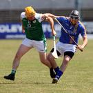 London's Henry Vaughan puts pressure on Wicklow's Garry Byrne during the Christy Ring Cup semi-final in Carlow. Photo: Joe Byrne