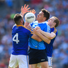 Paddy Andrews of Dublin in action against Diarmuid Masterson, left, and Patrick Fox of Longford during the Leinster Senior football championship semi-final in Croke Park.