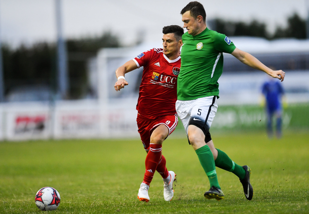 Graham Cummins of Cork City in action against Sean Heaney of Bray Wanderers