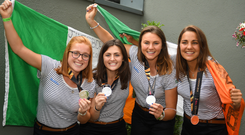 Ireland players from left, Zoe Wilson, Roisin Upton, Deirdre Duke and Lena Tice during the Irish Hockey Squad home coming from the Women's Hockey World Cup at Dublin Airport in Dublin. Photo: Sportsfile
