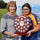 Captain Jenny Tyrrell accepts the trophy from Camogie Association President Kathleen Woods after Wicklows win in the All-Ireland Under 16 Camogie Progress to Success final at Abbotstown on Saturday