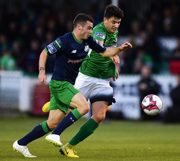 Joel Coustrain of Shamrock Rovers in action against Darragh Noone of Bray Wanderers
