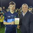 Man of the match John-Paul Nolan accepts the Wicklow People sponsored award from Colm Gaskin.