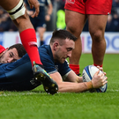 Bray's Jack Conan of Leinster dives over to score his side's first try during the Heineken Champions Cup Pool 1 Round 5 match between Leinster and Toulouse at the RDS Arena in Dublin