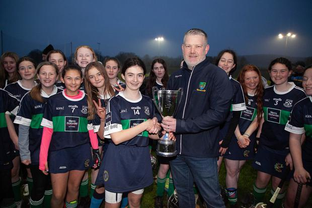 Wicklow Camogie Chairman Ivor Lehane presents Bray Emmets captain Emma Nesbitt with the camogie Féile under-14 cup