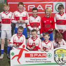 Scoil Naomh Brid, Knockananna, finalists in the SPAR FAI Primary Schools 5's Wicklow County Final, pictured in Arklow Town FC, with FAI representative Richard Fitzgibbon and SPAR representative Garry Healy. They will now progress on to the Leinster finals on May 16.