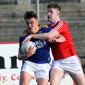Wickow's Daniel Cooney with Louth's Craig Shevlin tackling