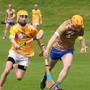 Wicklow Gold's Tom Moran heads for the Antrim goal