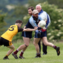 Shillelagh/Coolboy's Laurie Cullen tries to evade the challenge of Ashford's Cormac Doyle in Coolafancy