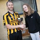 Brian Culleton's grandaughter Tara Casey presenting the Cup to Avoca captain Robert Wilson