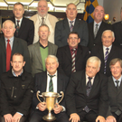 Jack Kilbride, front centre, pictured in The Lodge in Carnew among the men and representatives of the men he led to the historic senior double in 1973. The late Jack was captain of both the hurling and football teams in that memorable year.