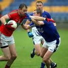 Rathnew's James Stafford tries to shake off the attentions of Dean Healy of St Pat's