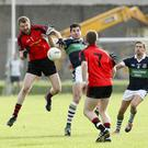 Coolkenno's Conor Doyle and Bray's Niall Gaffney compete for the ball