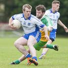 Aughrim's Rory O'Brien tries to shake off St Boden's Sean Murphy