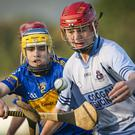 Carnew's Bradley Crosbie challenges Michael Dwyer's Eoghan Byrne during the U-16 'A' Championship Hurling final