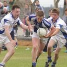 Jordan Pettigrew of St Patrick's bursts through the challenges of Eoin MacTeague and Sean Lawless