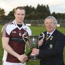 Coolboy captain Johnny Willoughby receives the Carter Cup from Co chairman Martin Coleman