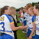 Wicklow captain Sarah Hogan introducing her team-mates to Marie Hickey, President of the LGFA and Sorcha Keane, Lidl, before the Division 4 League final