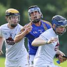 Wicklow's Christy Moorehouse is hit hard by Kildare's Eoin O'Heir