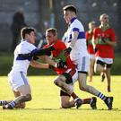 Diarmuid Connolly of St Vincent's and Rathnew's Damien Power battle for possession