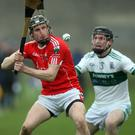 Glenealy's Danny Staunton makes a clearance as Keith Murphy of Portlaoise closes in