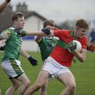 Ciaran Coffey of Rathnew battles past Jason Huntley and MJ Moran of St Nicholas during their Under-20 football championship match