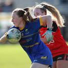 Amy Murphy of Wicklow is tracked by Down's Cliodhna Doherty