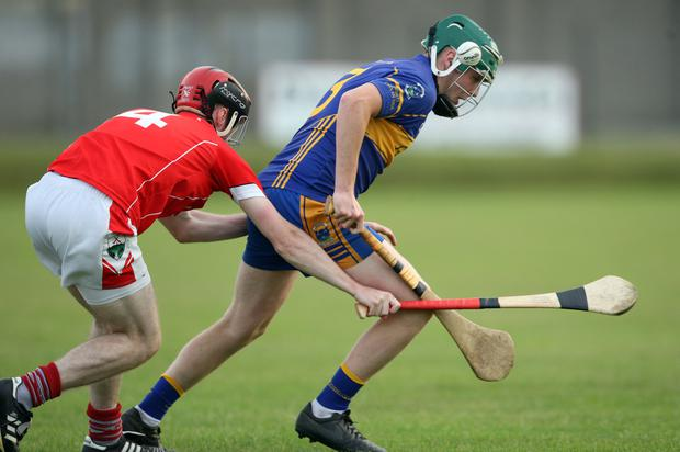 John Doyle of Carnew is tracked by Ronan Manley of Glenealy