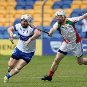 Andy O'Brien of St Patrick's tries to get past Kiltegan's Eoin O'Neill
