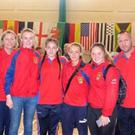 Tegan Farrell, Katie Twomey, Amber Byrne and Leanne Doyle with their coaches Linda Morgan and Paul Nolan.