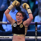 Katie Taylor celebrates victory in her WBA Inter-Continental Lightweight Championship bout with Nina Meinke