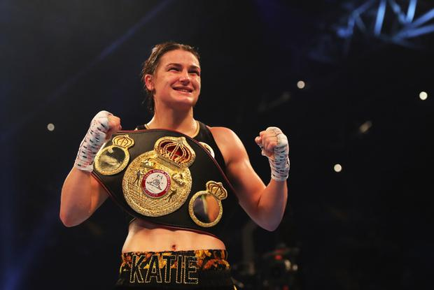 Katie Taylor celebrates victory after the WBA Lightweight World Championship contest against Anahi Sanchez at the Principality Stadium in Cardiff