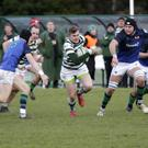 Paudie Geogheghan of Greystones makes some yards against Queen's University Belfast.