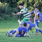 Paddy Costello of Arklow Celtic hurdles a couple of challenges