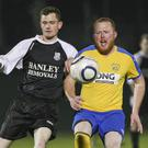 Newtown's Aaron Byrne and Seaview's Jamie Doyle chase down the ball