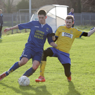 Alan Delaney of Wicklow Town is challenged by Joe Reid of Seaview Wanderers