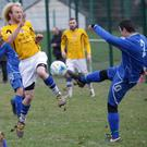 Ashford's Finn Brooks blocks a shot from Petru of Rialto FC