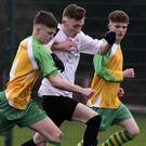 Rathnew's Jack Healy and Arklow Town's Clive Keenan compete for possession